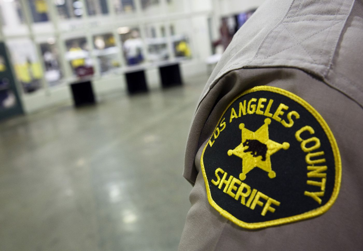 A Los Angels County Sheriff patch is seen on an officer